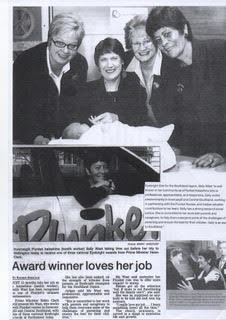 Sally receiving an honour from the then Prime Minister, Helen Clark